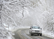 © Licensed to London News Pictures. 05/02/2012, Chinnor, UK. A car makes its way down a snow covered road in Chinnor.  People enjoy the snow in Chinnor, Oxfordshire today 05/02/12.  Heavy snow has fallen over many parts of the UK overnight. Photo credit : Stephen Simpson/LNP