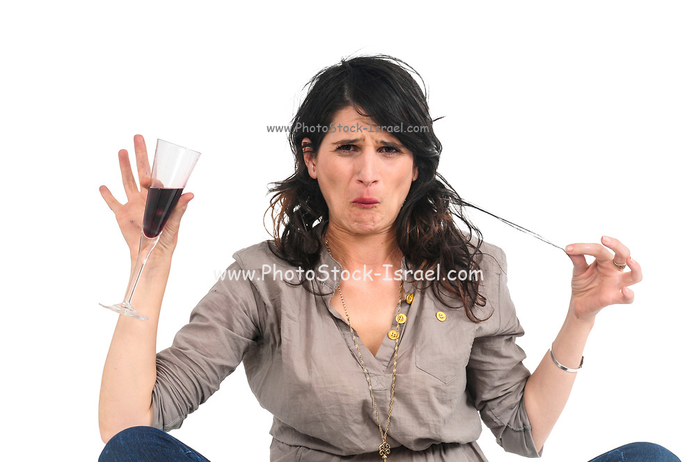 young woman drinks red wine studio shot on white background