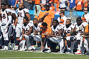 Some Denver Broncos players stand while others kneel during the playing of the National Anthem before the 2017 NFL week 3 regular season football game against the against the Buffalo Bills, Sunday, Sept. 24, 2017 in Orchard Park, N.Y. The Bills won the game 26-16. (©Paul Anthony Spinelli)