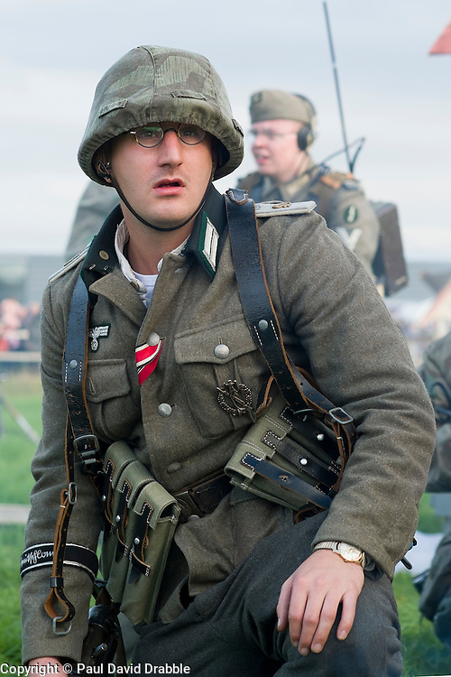 A Re-enactor portraying a  lieutenant in from Panzer Grenadier Division Grossdeutschland takes part in a battle battle re-enactment on Pickering Showground during the Pickering War Weekend<br /> <br /> 17/18 October 2015<br />  Image © Paul David Drabble <br />  www.pauldaviddrabble.co.uk