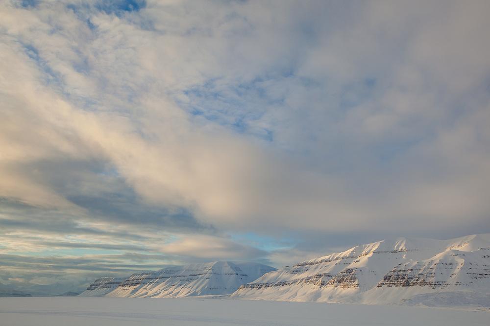 Sea ice fills Templefjorden, Svalbard. Gerardfjella (right) and Sindballefjellet are visible across the fjord.