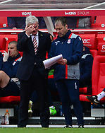 Mark Hughes, manager of Stoke city (l) looks on.  Premier league match, Stoke City v West Ham Utd at the Bet365 Stadium in Stoke on Trent, Staffs on Saturday 29th April 2017.<br /> pic by Bradley Collyer, Andrew Orchard sports photography.