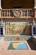 The tiled Alicante Alcove along the walls of the Plaza de Espana in Seville built in 1928 for the Ibero-American Exposition of 1929, Seville Spain . The Royal Alcázars of Seville (al-Qasr al-Muriq ) or Alcázar of Seville, is a royal palace in Seville, Spain. It was built by Castilian Christians on the site of an Abbadid Muslim alcazar, or residential fortress.The fortress was destroyed after the Christian conquest of Seville The palace is a preeminent example of Mudéjar architecture in the Iberian Peninsula but features Gothic, Renaissance and Romanesque design elements from previous stages of construction. The upper storeys of the Alcázar are still occupied by the royal family when they are in Seville. <br /> <br /> Visit our SPAIN HISTORIC PLACES PHOTO COLLECTIONS for more photos to download or buy as wall art prints https://funkystock.photoshelter.com/gallery-collection/Pictures-Images-of-Spain-Spanish-Historical-Archaeology-Sites-Museum-Antiquities/C0000EUVhLC3Nbgw <br /> .<br /> Visit our MEDIEVAL PHOTO COLLECTIONS for more   photos  to download or buy as prints https://funkystock.photoshelter.com/gallery-collection/Medieval-Middle-Ages-Historic-Places-Arcaeological-Sites-Pictures-Images-of/C0000B5ZA54_WD0s