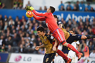 the ball falls to Laurent Koscielny of Arsenal as Swansea goalkeeper Lukasz Fabianski is 'fouled' or fumbles  and he scores his teams 2nd goal. Barclays Premier league match, Swansea city v Arsenal  at the Liberty Stadium in Swansea, South Wales  on Saturday 31st October 2015.<br /> pic by  Andrew Orchard, Andrew Orchard sports photography.
