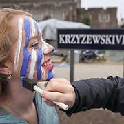 A student gets her face painted before the Duke-Louisville basketball game in Krzyzewskiville outside Cameron Indoor Stadium in Durham. Image used during broadcast of game. ©Travis Bell Photography
