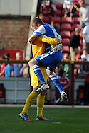 Leyton Orients Nathan Clarke (r) celebrates his sides win with keeper Ryan Allsop at the end of the match. NPower league one, Swindon Town v Leyton Orient at the County Ground in Swindon on Saturday 8th Sept 2012.  pic by  Andrew Orchard, Andrew Orchard sports photography,