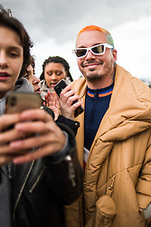 Colombian singer, J Balvin, poses with fans before the Louis Vuitton shows as part of Paris Haute Couture Fashion Week Spring/Summer 2019-2020 on January 17 in Paris, France. Photo by Julie Sebadelha/ABACAPRESS.COM
