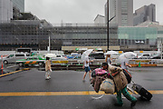 A homeless man pushes a bicycle carrying all his belongings in Shinjuku, Tokyo, Japan. Wednesday July 1st 2015