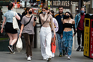 Young woman wearing facemasks are seen in the CBD during the COVID-19 in Melbourne. With over a week of zero cases in Victoria, Premier Daniel Andrews is expected to make major announcements on Sunday about further easing of restrictions. (Photo by Dave Hewison/Speed Media)
