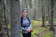 Kenaitze (Dena'ina) Indian Tribe Intern, Alyssa Stanton is showing house pits where people used to live long time ago. Alaska<br /> <br /> Photographer: Christina Sjögren<br /> <br /> Copyright 2019, All Rights Reserved