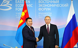September 7, 2017 - Vladivostok, Primorye Territory, Russia - September 7, 2017. - Russia, Primorye Territory, Vladivostok. - Russian President Vladimir Putin and President of Mongolia Khaltmaagiin Battulga (left) have a meeting at the 3rd Eastern Economic Forum. (Credit Image: © Russian Look via ZUMA Wire)