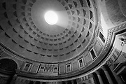 A sun ray passes through the oculus atop the Pantheon dome, Rome, Lazio, Italy. Full color image available upon request.
