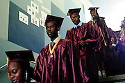 Christ the King Jesuit College Preparatory School founding students head to the school's First Commencement Exercises on Saturday, June 9th 2012. The institution is a beacon of hope amid one of the city's most impoverished neighborhoods, bucking low graduation rate trends with a 100% graduation and college acceptance rate. Brian J. Morowczynski~ViaPhotos..For use in a single edition of Catholic New World Publications, Archdiocese of Chicago. Further use and/or distribution may be negotiated separately. ..Contact ViaPhotos at 708-602-0449 or email brian@viaphotos.com.