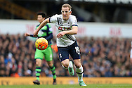 Harry Kane of Tottenham Hotspur wearing his protective face mask in action . Barclays Premier league match, Tottenham Hotspur v Swansea city at White Hart Lane in London on Sunday 28th February 2016.<br /> pic by John Patrick Fletcher, Andrew Orchard sports photography.