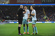 West Ham's James Tomkins (c) argues with referee Lee Mason after he had been shown a red card during the Barclays Premier league, Cardiff city v West Ham Utd match at the Cardiff city Stadium in Cardiff, South Wales on Saturday 11th Jan 2014.<br /> pic by Jeff Thomas, Andrew Orchard sports photography.