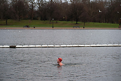 © Licensed to London News Pictures. 25/12/2011. LONDON, UK. A swimmer takes a quick dip in the Serpentine in London ahead of a Christmas Race taking place there today (25/12/2011). Members of the Serpentine Swimming Club today carried out their Christmas Day Swim, the race, known as the Peter Pan Cup after former patron and author JM Barrie, is a tradition dating back to 1864. Photo credit: Matt Cetti-Roberts/LNP
