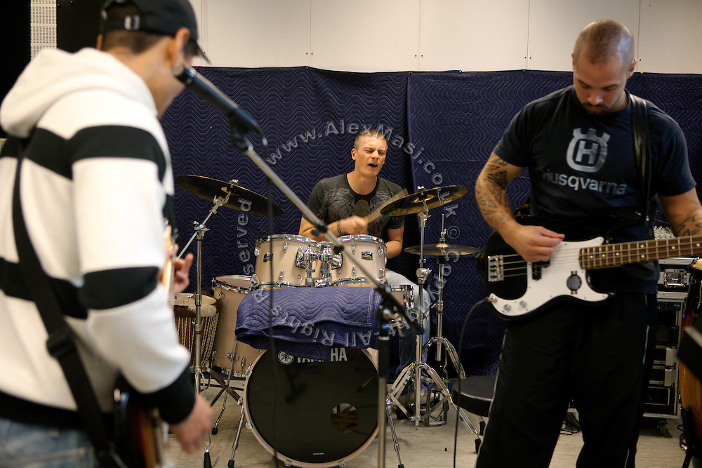 Inmates are practicing instruments in the professional recording studio where they regularly play as a band, built inside the luxurious Halden Fengsel, (prison) near Oslo, Norway.