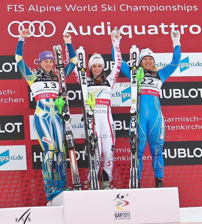 11-02-2011 SKIEN: FIS ALPINE WORLD CHAMPIONSSHIP: GARMISCH PARTENKIRCHEN<br /> Winners Presentation, Tina Maze (SLO), Gold Medal and World Champion Anna Fenninger (AUT), bronze Medal for Anja Paerson (SWE) during ladies Supercombi<br /> **NETHERLANDS ONLY**<br /> ©2011-WWW.FOTOHOOGENDOORN.NL/EXPA/ J. Groder