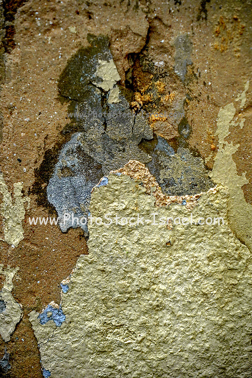 Paint and plaster peeling off a wall