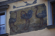 Fresco of the Three Ostriches, a house sign marking a building from 1597 now a hotel & restaurant in Prague, Czech Republic. House signs were used in early Prague before house numbers were created.