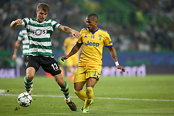 October 31, 2017 - Lisbon, Portugal - Sporting's defender Stefan Ristovsk from Macedonia (L) vies with Juventus' Brazilian forward Douglas Costa during the UEFA Champions League football match Sporting CP vs Juventus at the Alvalade stadium in Lisbon, Portugal on October 31, 2017. (Credit Image: © Pedro Fiuza/NurPhoto via ZUMA Press)