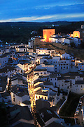 Easter procession at night through streets of Setenil de las Bodegas, Cadiz province, Spain