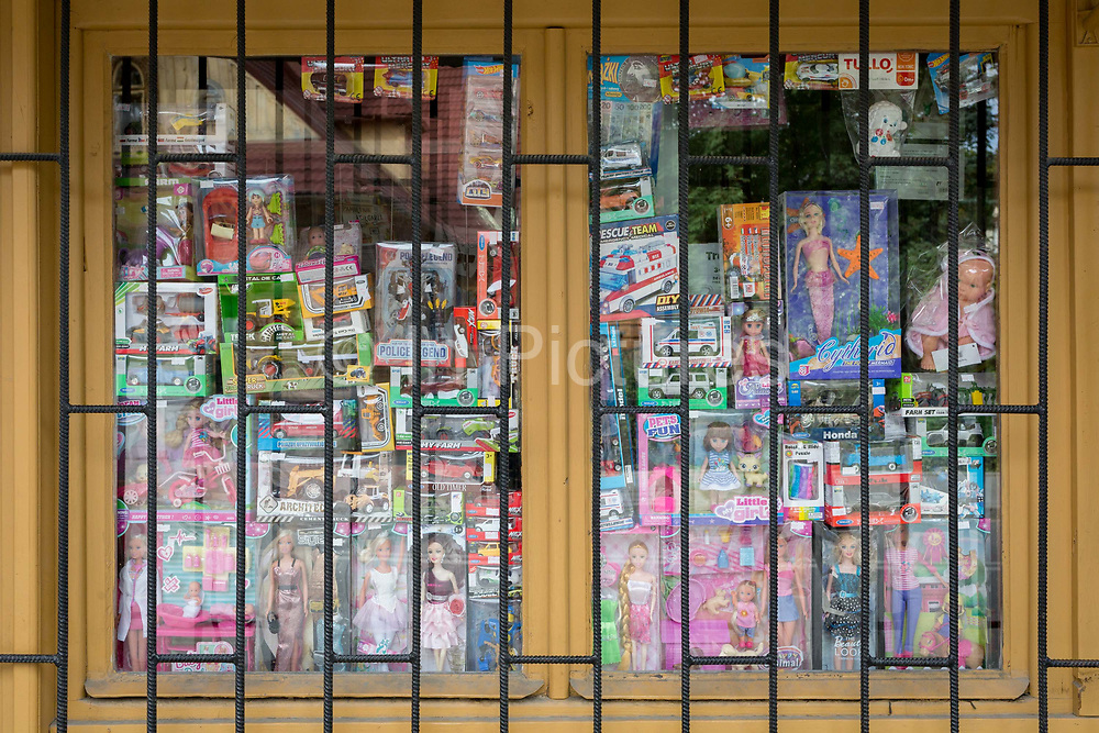 A detail of a Polish shop window selling assorted childrens toys and girls dolls, on 16th September 2019, in Zakopane, Malopolska, Poland.