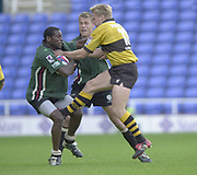 Reading, Berkshire, 29/09/02<br /> London Irish vs Wasps,<br /> Exiles Paul Sackey, is tackle by Stuart Abbott, during the ZURICH PREMIERSHIP RUGBY match at the Madejski Stadium,  [Mandatory Credit: Peter Spurrier/Intersport Images],