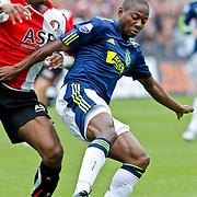 NLD/Rotterdam/20100919 - Voetbalwedstrijd Feyenoord - Ajax 2010, Eyong Enoh in duel met Georginio Wijnaldum