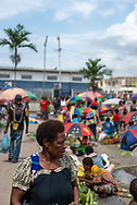 A woman walks at the market in Wewak, Papua New Guinea, on July 21, 2017. Wewak is the capital of the East Sepik Province.