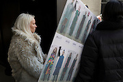 """Staff from a fashion house carry equipment, including the models' catwalk running order outisde London Fashion Week in the Strand, on 17th Febriary 2017, in London, England, United Kingdom. London Fashion Week is a clothing trade show held in London twice each year, in February and September. It is one of the """"Big Four"""" fashion weeks, along with the New York, Milan and Paris. The fashion sector plays a significant role in the UK economy with London Fashion Week alone estimated to rake in £269 million each season. The six-day industry event allows designers to show their collections to buyers, journalists and celebrities and also maintains the city's status as a top fashion capital."""
