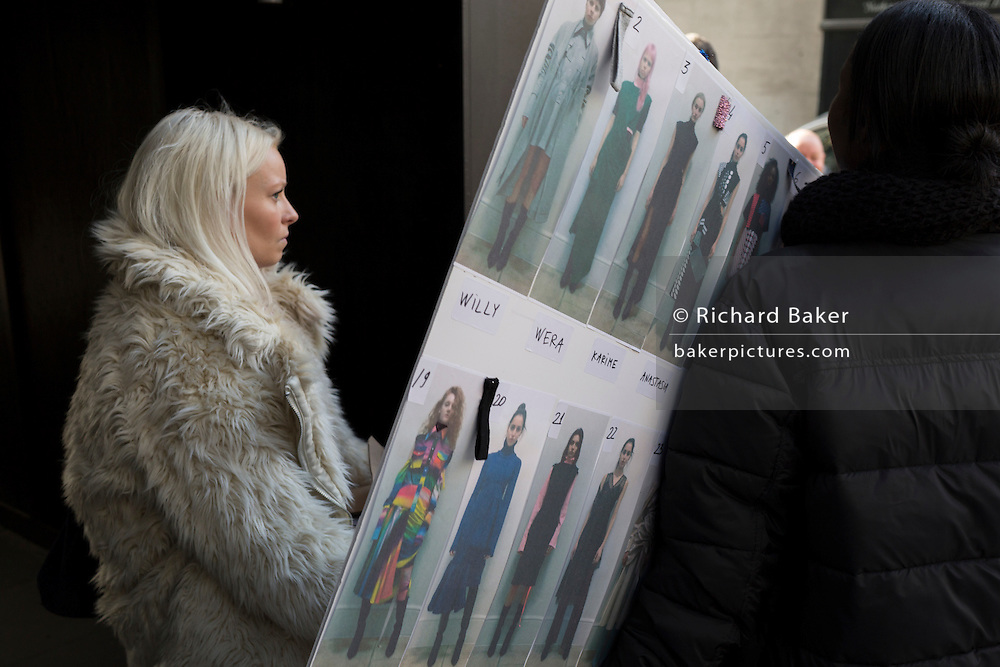 "Staff from a fashion house carry equipment, including the models' catwalk running order outisde London Fashion Week in the Strand, on 17th Febriary 2017, in London, England, United Kingdom. London Fashion Week is a clothing trade show held in London twice each year, in February and September. It is one of the ""Big Four"" fashion weeks, along with the New York, Milan and Paris. The fashion sector plays a significant role in the UK economy with London Fashion Week alone estimated to rake in £269 million each season. The six-day industry event allows designers to show their collections to buyers, journalists and celebrities and also maintains the city's status as a top fashion capital."
