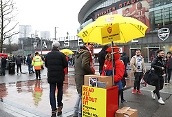 Official programmes on sale outside the stadium prior to the Premier League match at the Emirates Stadium, London.
