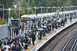 © Licensed to London News Pictures. 15/10/2018<br /> PETTSWOOD, UK.<br /> Rain hell for London commuters at Pettswood train station, Pettswood.<br /> Heavy rain over night and this morning has flooded roads in South East London.<br /> Photo credit: Grant Falvey/LNP