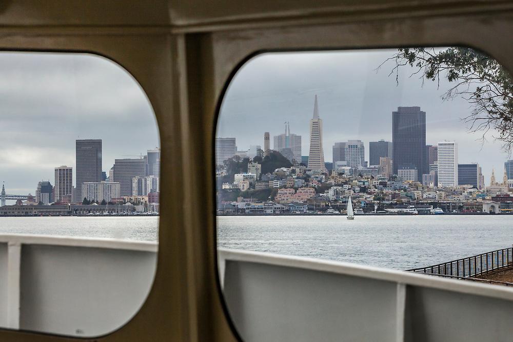 San Fransico through the windows of the Alcatraz Ferry boat docked on Alcatraz Island, San Fransisco Bay, California, USA.