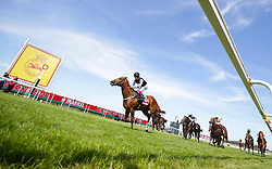 Rumble Inthejungle ridden by jockey Tom Queally on his way to winning the Markel Insurance Molecomb Stakes during day two of the Qatar Goodwood Festival at Goodwood Racecourse, Chichester.