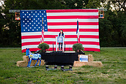 12 SEPTEMBER 2020 - DES MOINES, IOWA: THERESA GREENFIELD, the Democratic candidate for US Senate speaks at the Polk County Democrats Steak Fry in Waterworks Park in Des Moines. The stage was socially distanced from the attendees, who listened to the program from their cars. The Steak Fry is the largest fundraiser of the year for Polk County Democrats. This year nearly 1,000 people attended. The Steak Fry observed public health guidelines. Normally the Steak Fry is a picnic but this year people stayed in their cars while meals were brought to them and they wore masks when they were outside of the cars. Most of the speakers appeared via online speeches.      PHOTO BY JACK KURTZ