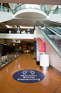 A social distancing sign is seen in an empty Southbank Shopping Mall during COVID-19 in Melbourne, Australia. Hotel quarantine linked to 99% of Victoria's COVID-19 cases, inquiry told. This comes amid a further 222 new cases being discovered along with 17 deaths. Melbourne continues to reel under Stage 4 restrictions with speculation that it will be extended. (Photo by Dave Hewison/Speed Media)