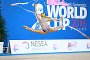 Uchida Katherine during qualifying at ribbon in Pesaro World Cup 02 April 2016. Katherine is a canadian individual rhythmic gymnast, was born in Markham, 1999.
