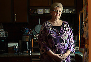 """Barbara Saltsman, 64, stands in the kitchen of her home in Chittenango, N.Y., Thursday, January 5, 2012. Saltsman lost her job as a patent paralegal in May, 2011. """"When the unemployment runs out, I will give up looking,"""" said Saltsman, of looking for a job because, she said, there are no jobs for people her age without a college degree. .(Heather Ainsworth for The New York Times)"""