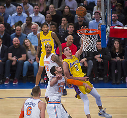 December 12, 2017 - Manhattan, NY, USA - The Los Angeles' Lakers Lonzo Ball (2) glides in with a shot against the New York Knicks at Madison Square Garden in New York on Tuesday, Dec. 12, 2017. The Knicks won, 113-109, in overtime. (Credit Image: © Howard Simmons/TNS via ZUMA Wire)