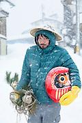 Portrait of smiling man standing in snow, Nozawaonsen, Japan