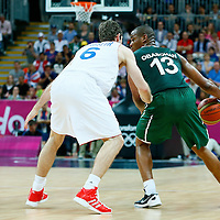 06 August 2012: Nigeria Derrick Obasohan looks to pass over France Fabien Causeur during 79-73 Team France victory over Team Nigeria, during the men's basketball preliminary, at the Basketball Arena, in London, Great Britain.