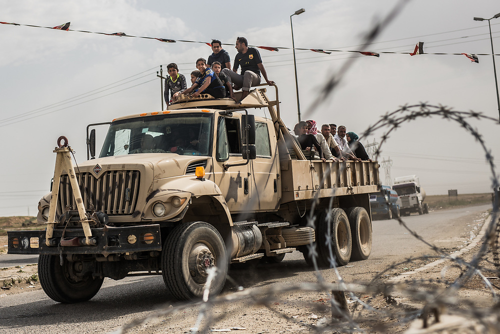 People flee from West Mosul.