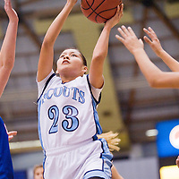 021613       Cable Hoover<br /> <br /> Window Rock Scout Caleigh Curley (23) drives through the Camp Verde Cowboys defense during the Arizona State Tournament at the NAU Walkup Skydome in Flagstaff Saturday.