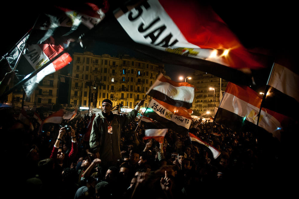 On the eighteenth day of protests in Tahrir Square, Cairo, Egyptian protester wave flags and chant slogans calling for the ouster of President Hosni Mubarak.