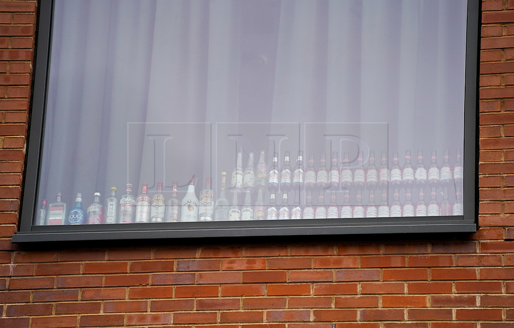 © Licensed to London News Pictures. 26/09/2020. Sheffield, UK.   Beer bottles are stacked up in the window in student accommodation near University of Sheffield.  843 students from the University of Sheffield and Sheffield Hallam University have tested positive for coronavirus, following a spike in coronavirus cases. Photo credit: Ioannis Alexopoulos/LNP