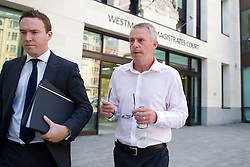 © London News Pictures. 19/07/2013. London, UK.  Former Trader James Gilmour (right) leaving Westminster Magistrates Court in London where he was one of two traders charged with conspiracy to defraud in relation to the Serious Fraud Office investigation into the manipulation of LIBOR.  Photo credit : Ben Cawthra/LNP