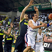 Efes Pilsen's Kerem TUNCERI (R), Mario KASUN (B) and Fenerbahce Ulker's Oguz SAVAS (C), Mirsad TURKCAN (L) during their Turkish Basketball league Play Off Final first leg match Efes Pilsen between Fenerbahce Ulker at the Ayhan Sahenk Arena in Istanbul Turkey on Thursday 20 May 2010. Photo by Aykut AKICI/TURKPIX