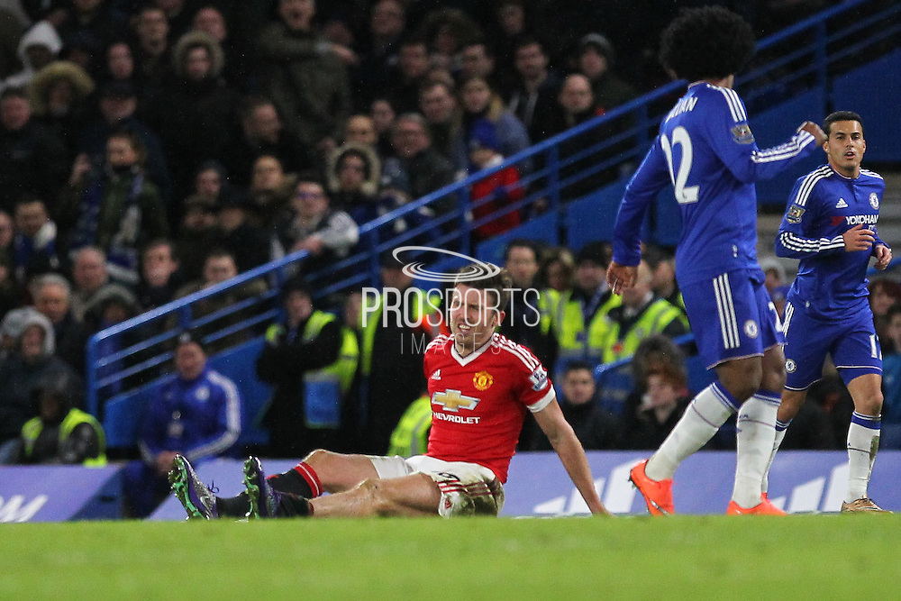 Michael Carrick is injured during the Barclays Premier League match between Chelsea and Manchester United at Stamford Bridge, London, England on 7 February 2016. Photo by Phil Duncan.